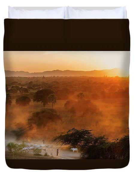 Duvet Cover featuring the photograph Farmer Returning To Village In The Evening by Pradeep Raja Prints