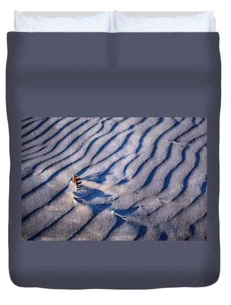 Duvet Cover featuring the photograph Feather In Sand by Michelle Calkins