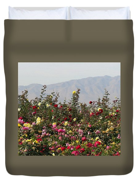 Duvet Cover featuring the photograph Field Of Roses by Laurel Powell