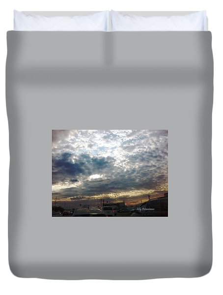 Duvet Cover featuring the pyrography Fierce Skies by Elly Potamianos