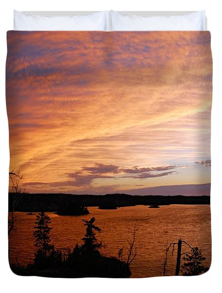 Fiery Sunset Over Seagull Lake Duvet Cover by Larry Ricker