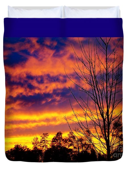Duvet Cover featuring the photograph Fire In The Sky by Sue Melvin