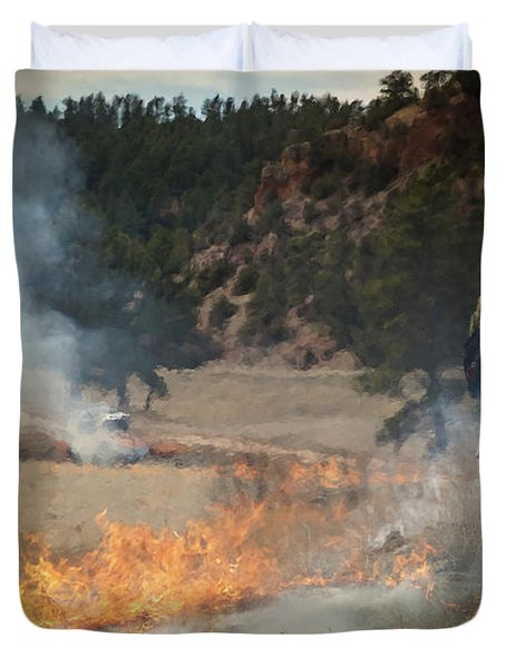 Duvet Cover featuring the photograph Firefighter Ignites The Pleasant Valley Prescribed Fire by Bill Gabbert