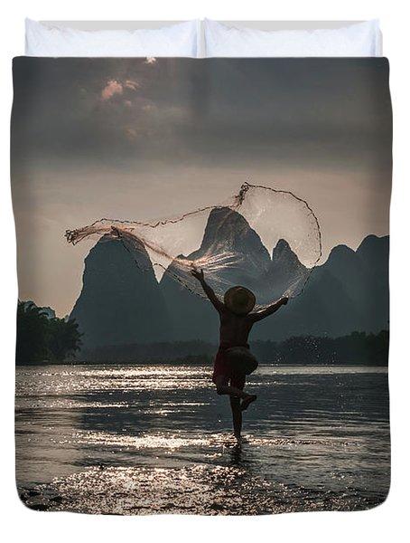 Fisherman Casting A Net. Duvet Cover