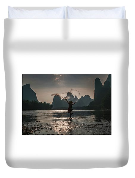 Fisherman Casting A Net. Duvet Cover