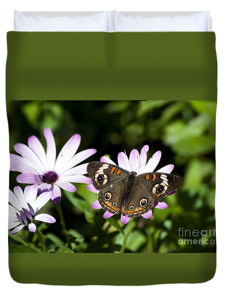 Duvet Cover featuring the photograph Fleurs Violettes Adorned With A Papillon by Ruth Jolly