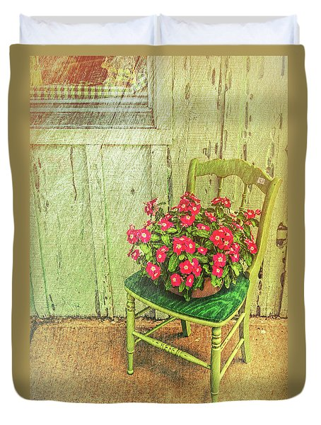 Duvet Cover featuring the photograph Flowers On Green Chair by Lewis Mann