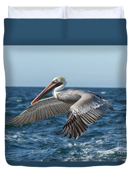 Duvet Cover featuring the photograph Flying Brown Pelican by Robert Bales