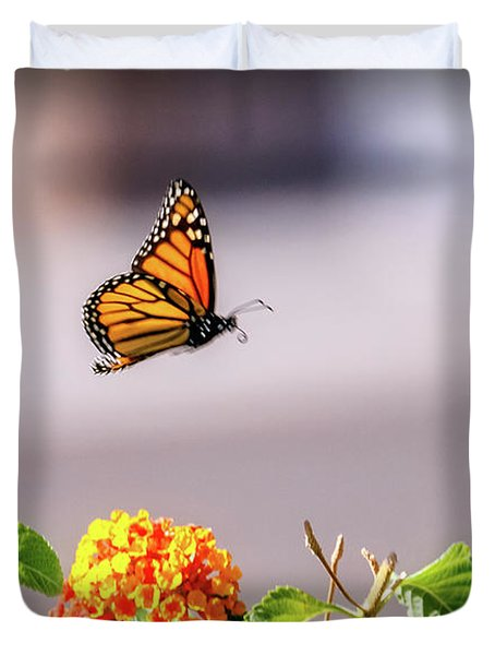 Duvet Cover featuring the photograph Flying Monarch Butterfly by Robert Bales