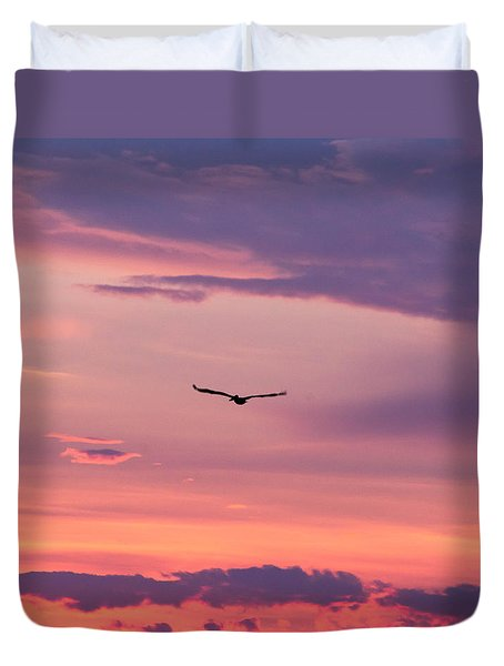 Flying Pelican At Sunset Duvet Cover