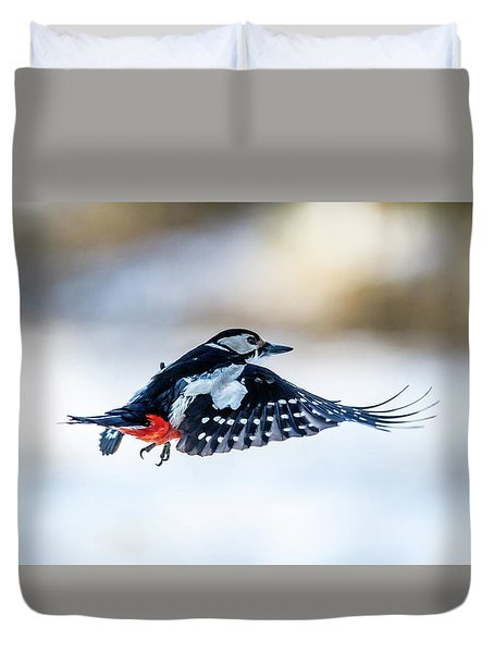 Duvet Cover featuring the photograph Flying Woodpecker by Torbjorn Swenelius