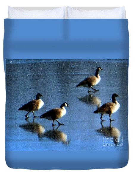 Four Geese Walking On Ice Duvet Cover