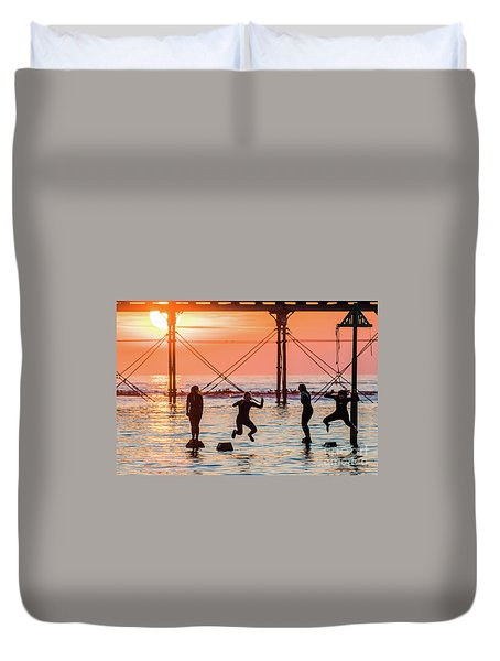 Four Girls Jumping Into The Sea At Sunset Duvet Cover