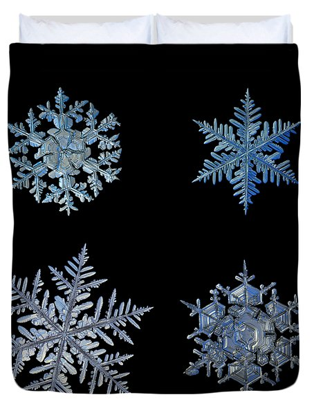 Four Snowflakes On Black Background Duvet Cover