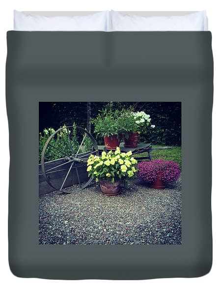 Garden Decorated With Flowers And Old Wheel Duvet Cover