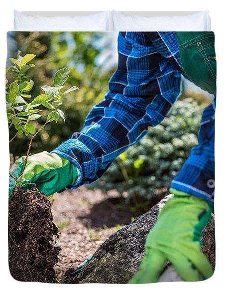 Gardener Planting New Tree In A Garden. Duvet Cover