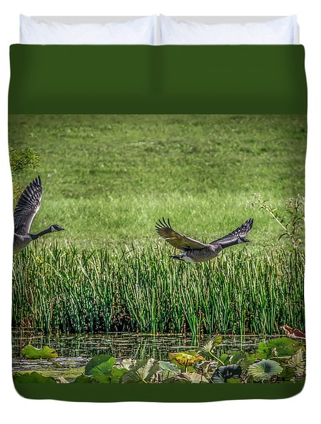 Geese In Flight Duvet Cover by Ray Congrove