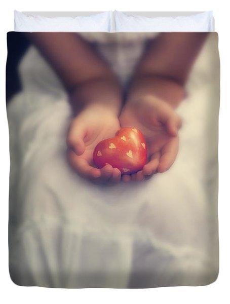 Girl Is Holding A Heart Duvet Cover by Joana Kruse