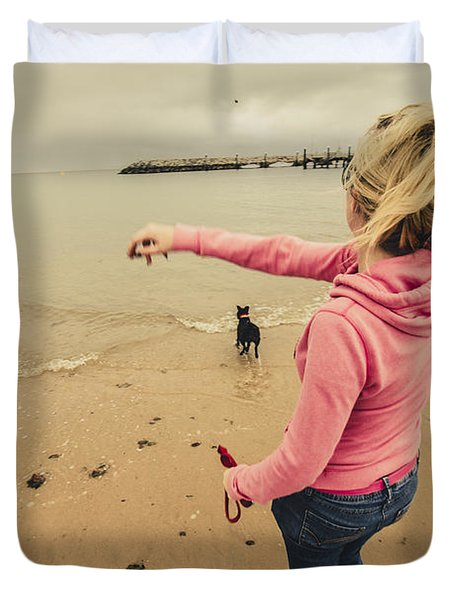 Girl Playing Fetch On Overcast Day Duvet Cover