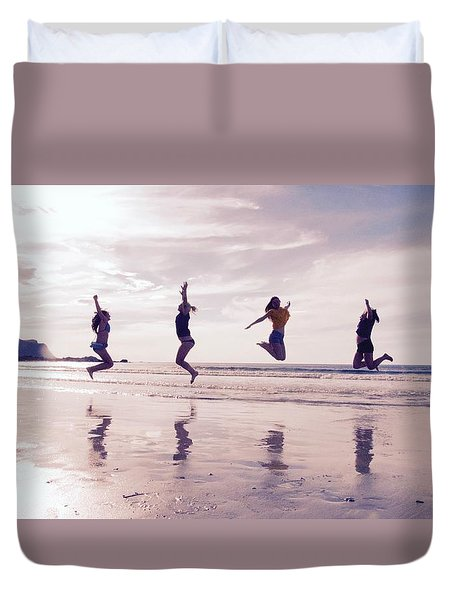 Girls Jumping On Lofoten Beach Duvet Cover by Tamara Sushko