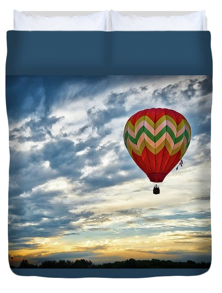 Gliding Through Sunset Duvet Cover