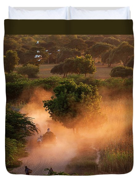 Duvet Cover featuring the photograph Going Home At Sunset by Pradeep Raja Prints