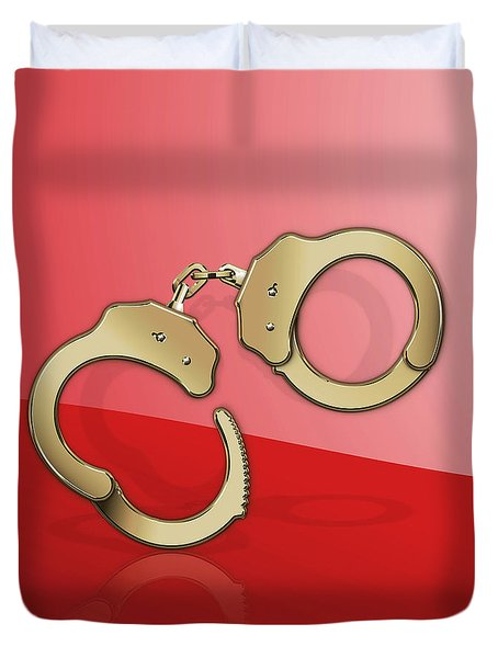 Gold Handcuffs On Red Duvet Cover