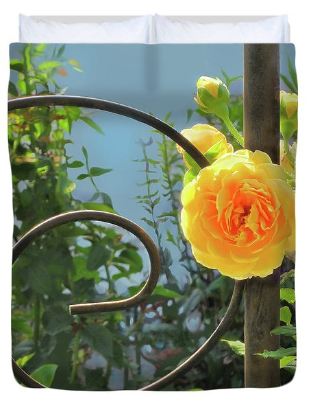 Duvet Cover featuring the photograph Golden Ruffled Rose On Iron Trellis by Nancy Lee Moran