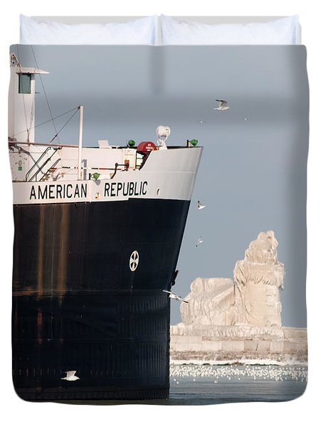 Great Lakes Ship Passing A Frozen Cleveland Lighthouse Duvet Cover