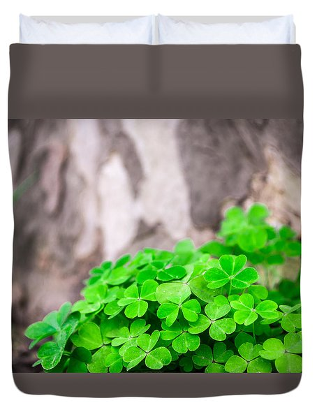 Duvet Cover featuring the photograph Green Clover And Grey Tree by John Williams