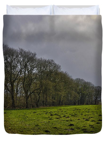 Group Of Trees Against A Dark Sky Duvet Cover
