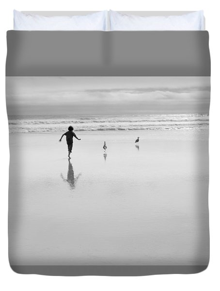 Duvet Cover featuring the photograph Gull Chasing 101 by Lora Lee Chapman