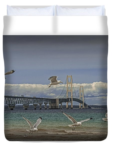 Gulls Flying By The Bridge At The Straits Of Mackinac Duvet Cover by Randall Nyhof