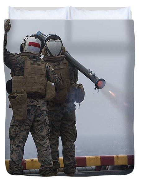 gunners launch a missile from the Stinger launch on the flight deck of the amphibious assault ship Duvet Cover