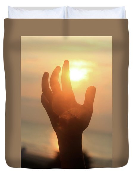 Hand Reaching Fore The Sun Duvet Cover