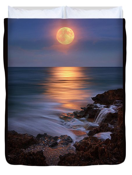 Duvet Cover featuring the photograph Harvest Moon Rising Over Beach Rocks On Hutchinson Island Florida During Twilight. by Justin Kelefas