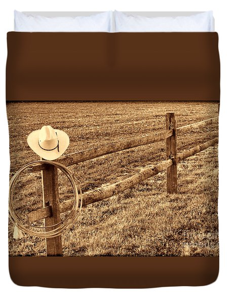 Hat And Lasso On Fence Duvet Cover
