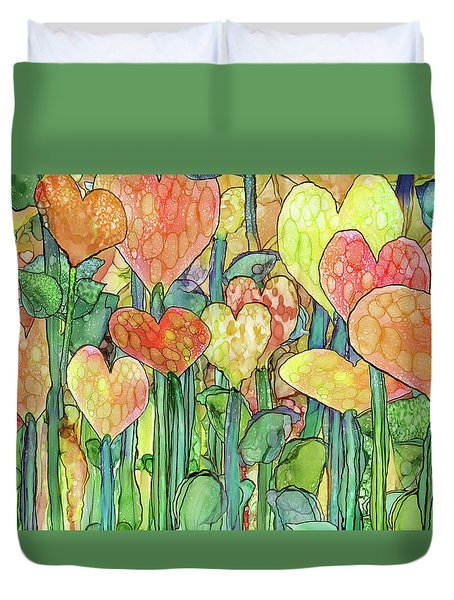 Duvet Cover featuring the mixed media Heart Bloomies 3 - Golden by Carol Cavalaris