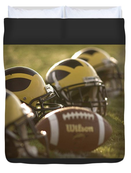 Helmets And A Football On The Field At Dawn Duvet Cover