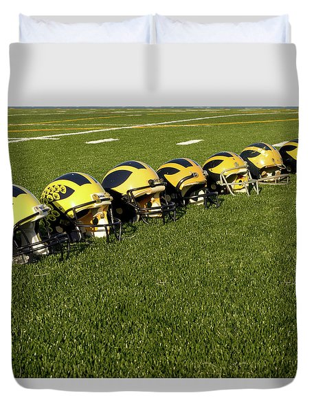 Helmets Of Different Eras On The Field Duvet Cover