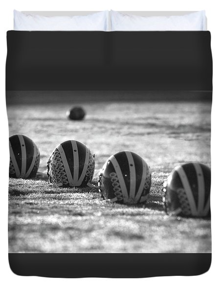 Helmets On Dew-covered Field At Dawn Black And White Duvet Cover