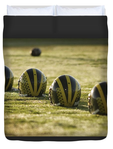 Helmets On Dew-covered Field At Dawn Duvet Cover