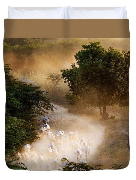 Duvet Cover featuring the photograph herd and farmer going home in the evening, Bagan Myanmar by Pradeep Raja Prints