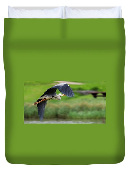 Duvet Cover featuring the photograph Heron Flying Turning In Flight by Scott Lyons