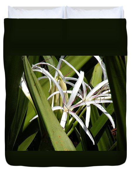 Duvet Cover featuring the photograph Hidden Swamp Lily by Rosalie Scanlon