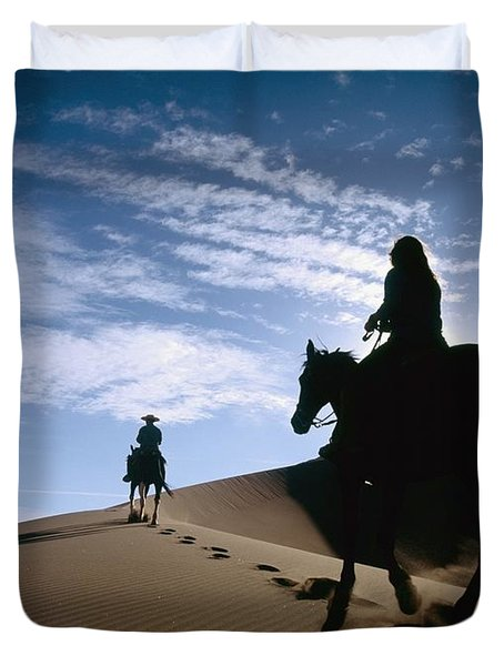 Horseback Riders In Silhouette On Sand Duvet Cover by Axiom Photographic