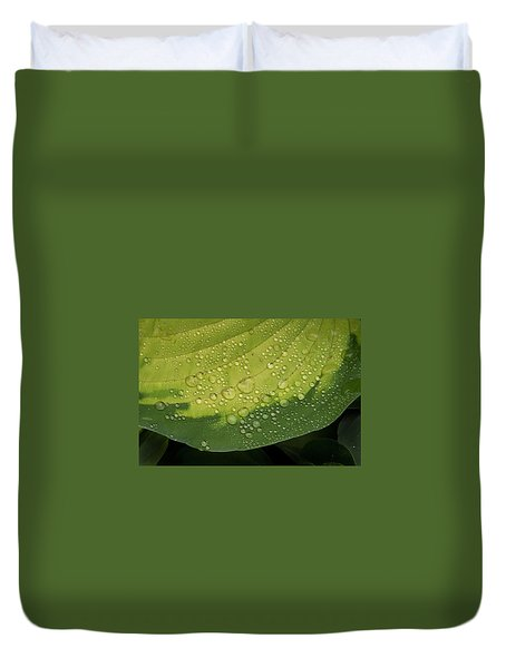 Duvet Cover featuring the photograph Hosta Drops by Jean Noren
