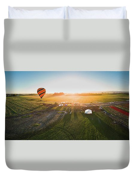 Duvet Cover featuring the photograph Hot Air Balloon Taking Off At Sunrise by William Lee