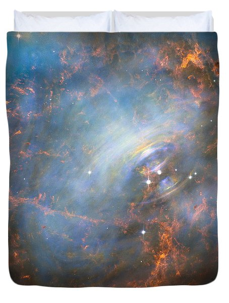 Duvet Cover featuring the photograph Hubble Captures The Beating Heart Of The Crab Nebula by Nasa