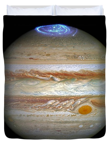 Duvet Cover featuring the photograph Hubble Captures Vivid Auroras In Jupiter's Atmosphere by Nasa